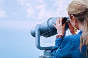 girl-sea-binoculars-vacation-160514
